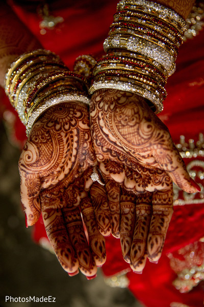 Magnificent Indian bride's bangles and mehndi art.