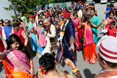 Cheerful Indian baraat procession capture.