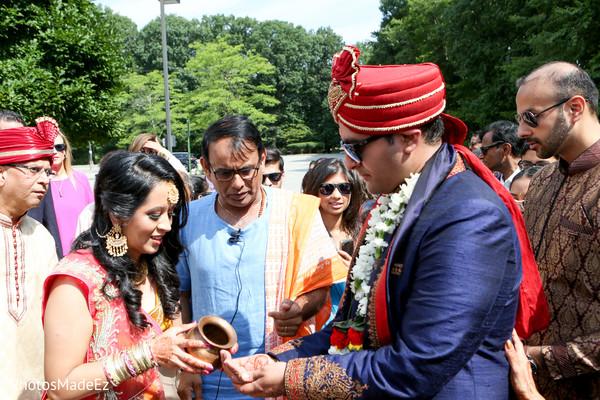 Closeup capture of Indian groom at baraat ritual.