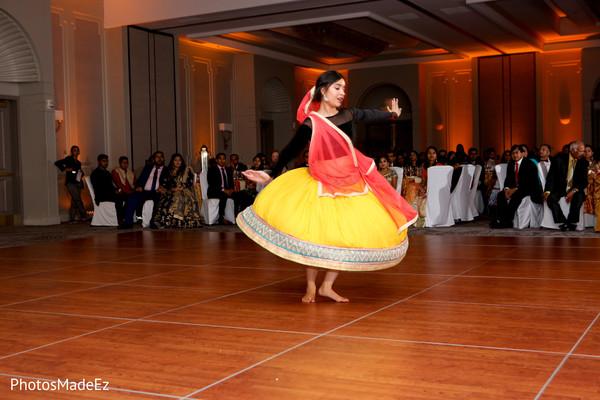 Marvelous Indian wedding reception dancer.