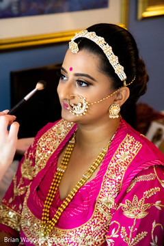 Beautiful Indian bride being dolled up for her ceremony.