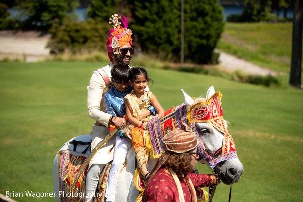 Indian groom riding the ghodi with kids
