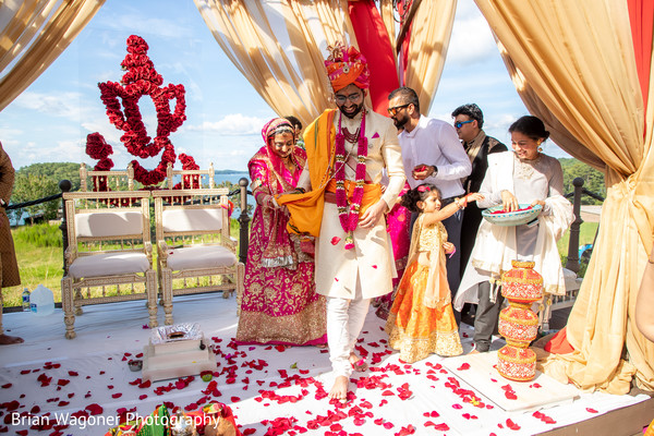 Bride and groom under the beautiful mandap