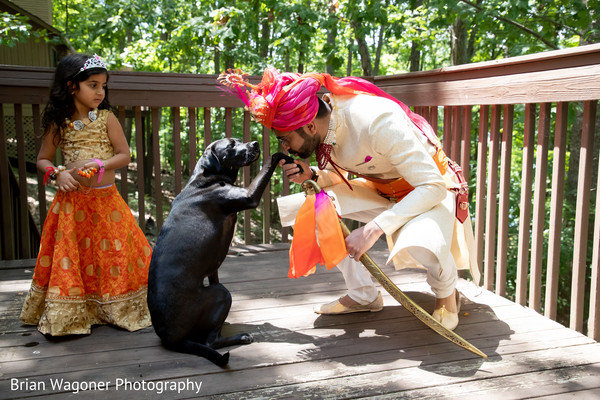 Lovely shot of Indian groom and his pet