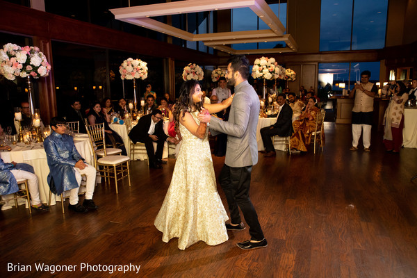 Indian groom and bride having their first dance