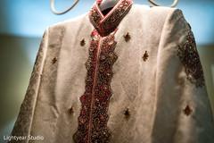 Stunning Indian groom's sherwani photo.