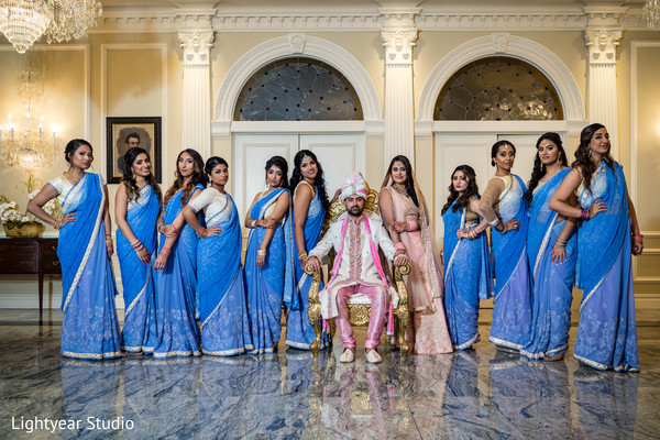 Indian bride and groom with bridesmaids capture.