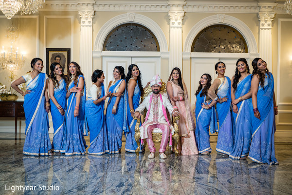 Indian bride and groom with bridesmaids wedding portrait.