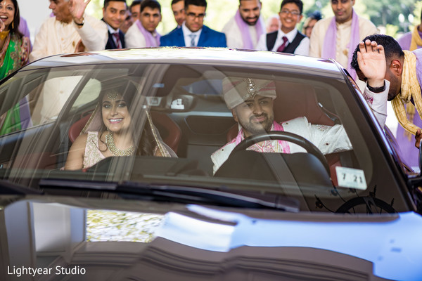 Indian bride and groom leaving the ceremony capture.