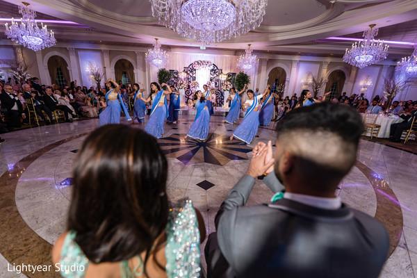 Indian wedding reception bridesmaids dance.