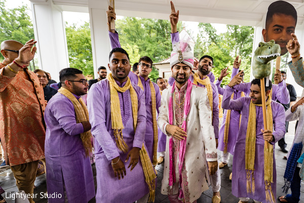Charming Indian groom capture at the baraat celebration.