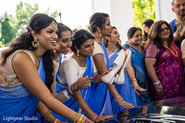 Indian bridesmaids at the traditional wedding game.
