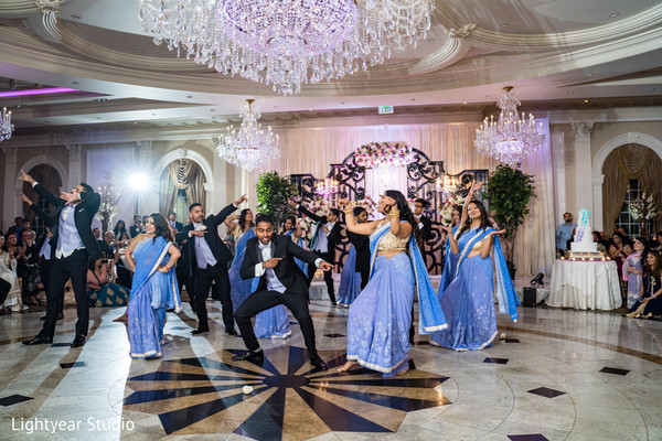 Upbeat indian bride's and groomsmen dance performance.