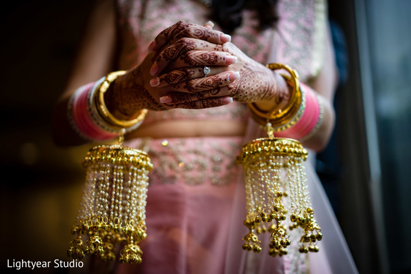 Indian bride showing her Kalires.