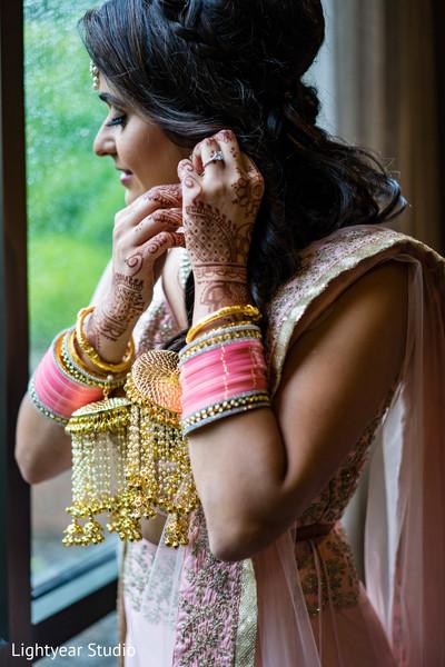 Indian bride getting her earrings on.