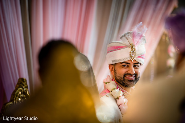 Charming Indian groom at ceremony capture.