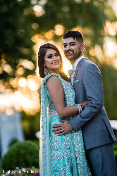 Elegant Indian bride and groom's wedding reception fashion.