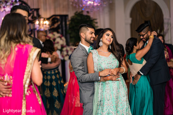 Indian bride and groom reception dance capture.