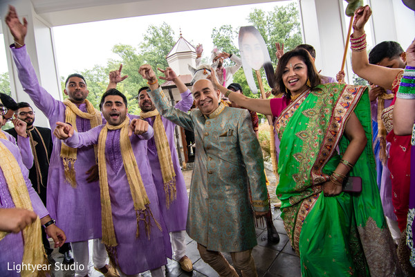 Indian wedding guests at baraat celebration.