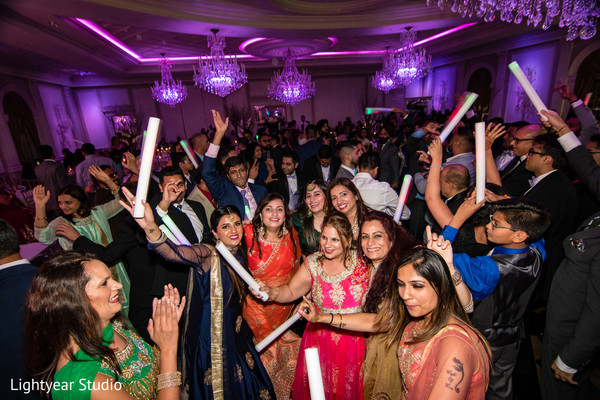 Indian wedding guests dancing photography.