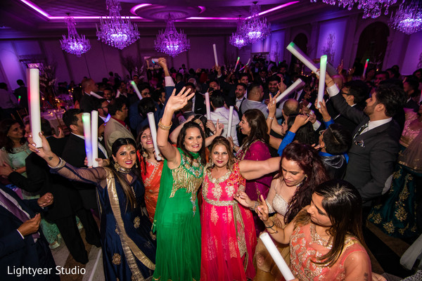 Indian wedding guests dancing photography