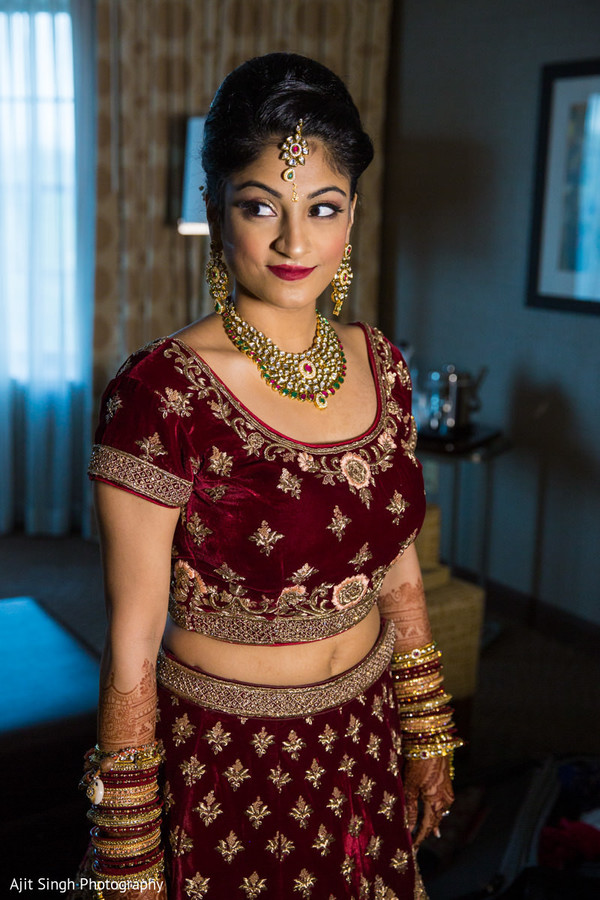 Stunning Indian bride posing for pictures