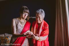 Indian bride and relative admiring henna art.