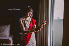 Indian bride getting ready for her ceremony.