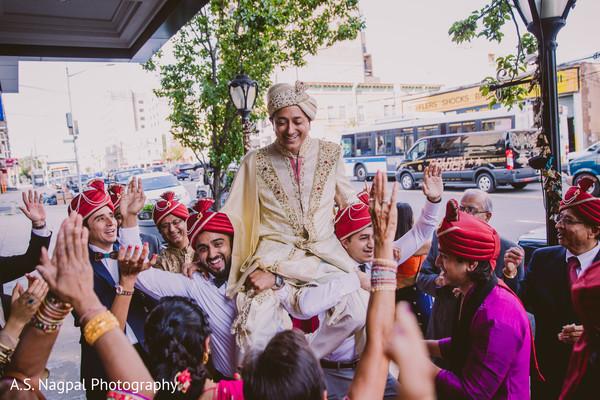Rajah being lifted by groomsmen at baraat.