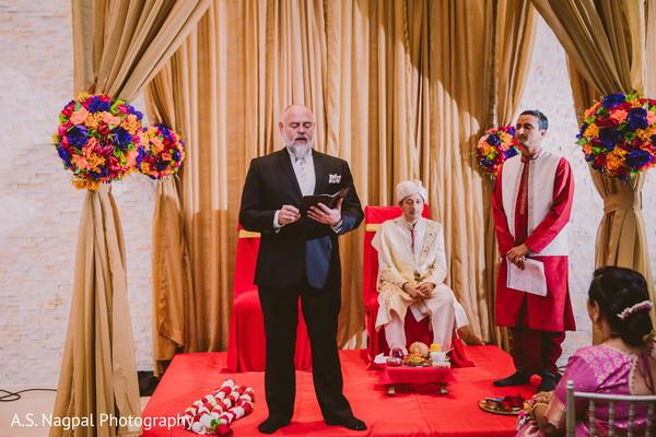 Indian wedding ceremony priest capture.
