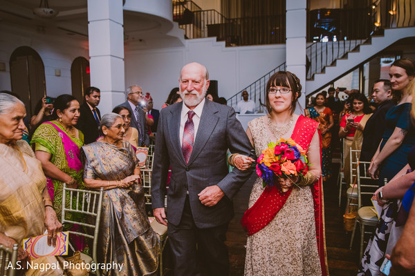 Lovely Indian bride with father walking down the aisle.
