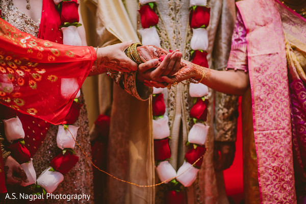 Indian wedding ritual when holding the rose petals.