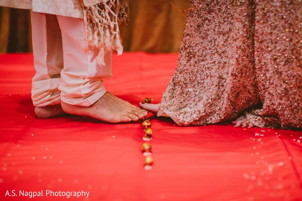 Indian bride and groom at the Saptapadi ritual.