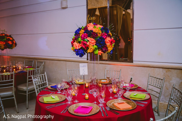 Marvelous Indian wedding table flowers and  candle decoration.