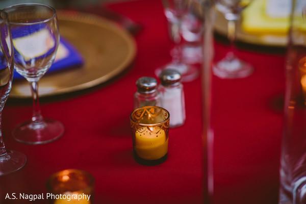 Enchanting Indian wedding table candle decor.