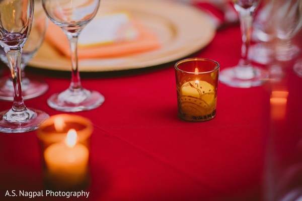 Detailed Indian wedding candle table decorations.