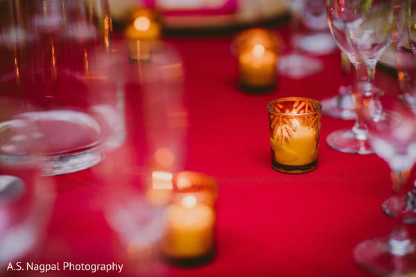 Lovely Indian wedding table candles decoration.