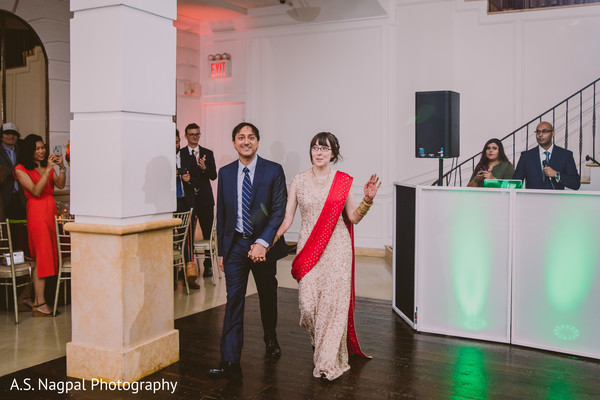 Indian bride and groom making their entrance to reception party.