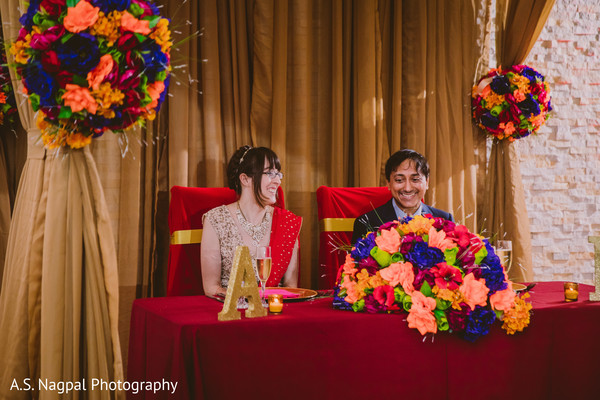 Joyful Indian couple at their reception party.