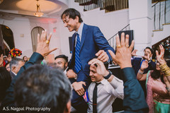 Rajah being lifted by groomsmen at reception.