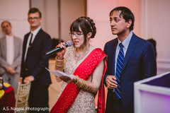 Indian bride and groom giving out a speech.