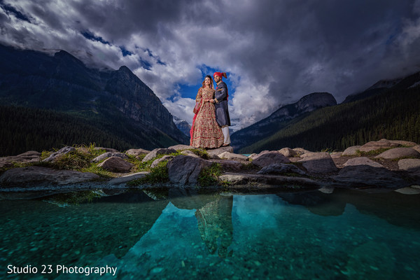 Amazing shot of Indian bride and groom by the river