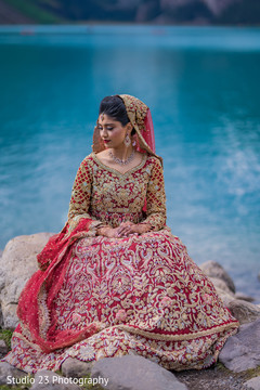 Indian bride posing with her amazing lengha