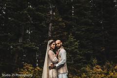Indian bride hugging the Raja outdoors