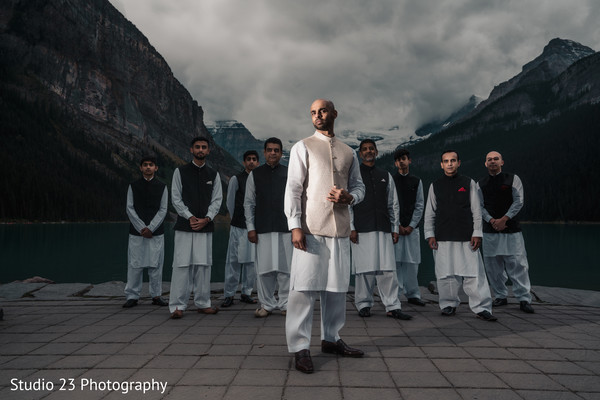 Raja posing with elegant groomsmen
