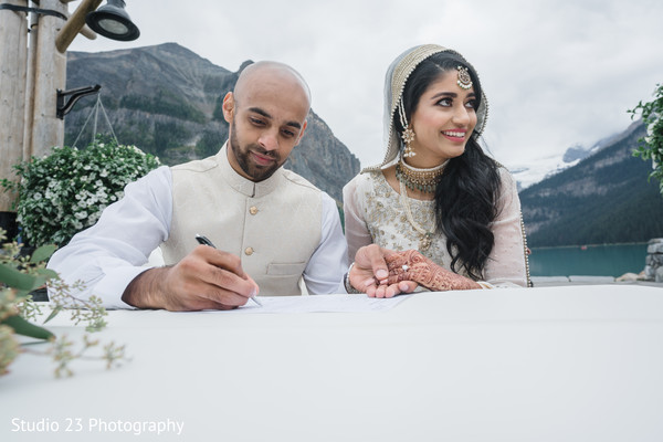 See this Indian couple signing the wedding papers