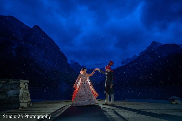 Amazing shot of Indian newlyweds outdoors