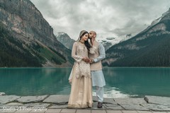Raja kissing the Indian bride by the lake