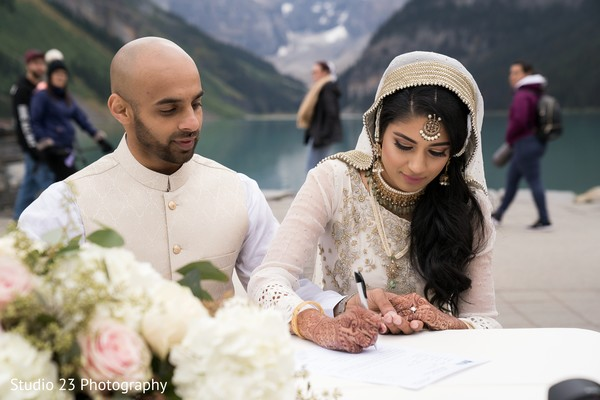 Indian bride signing the wedding contract