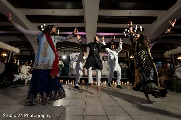 Indian groom and special guests dancing